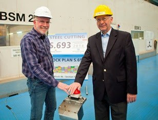 Kevin Sheehan, chief executive officer of Norwegian Cruise Line, and Bernard Meyer, managing director of MEYER WERFT, press the button to start the first steel cutting for Norwegian Escape.