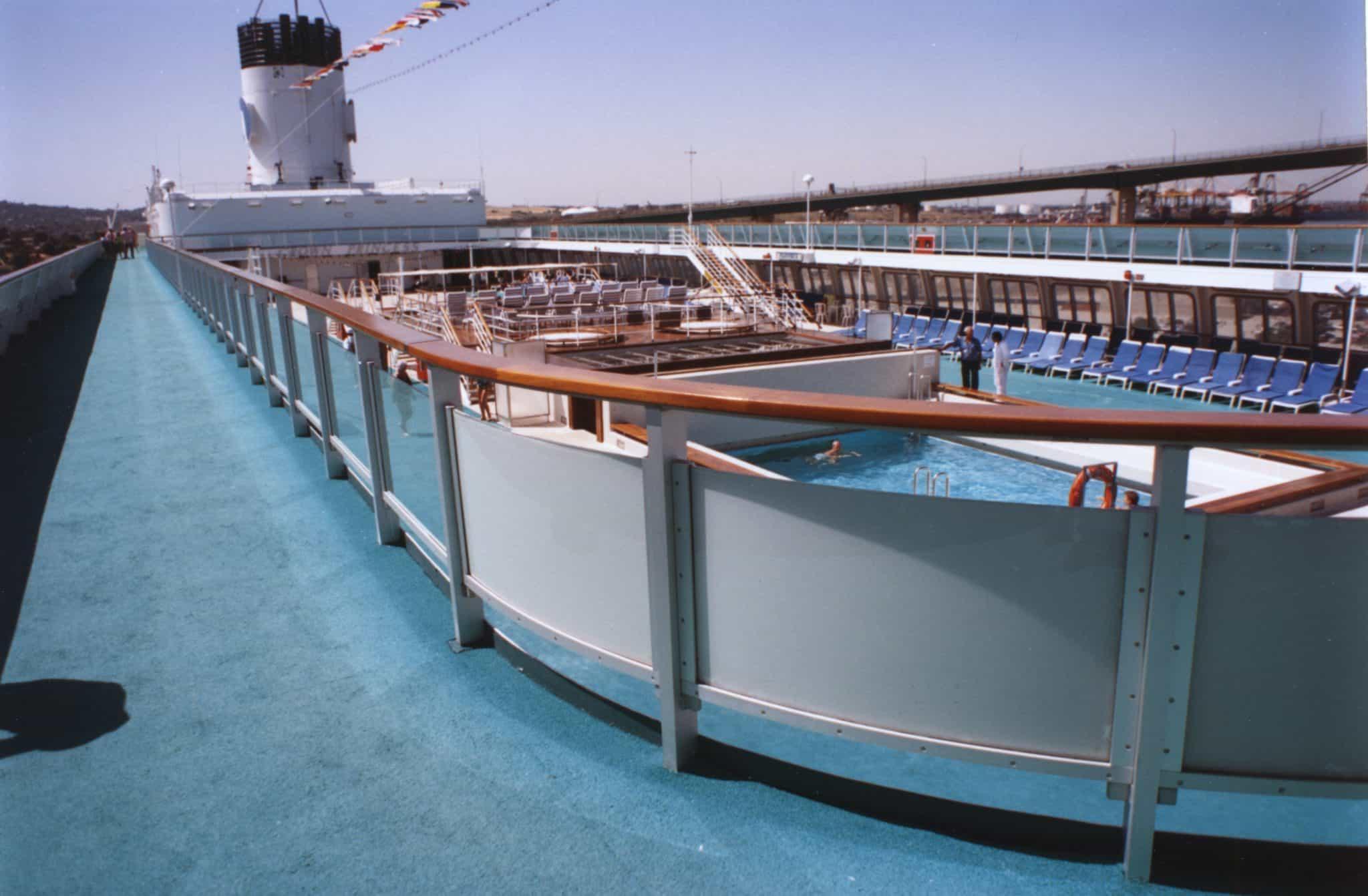 Starboard sun deck promenade, facing aft.