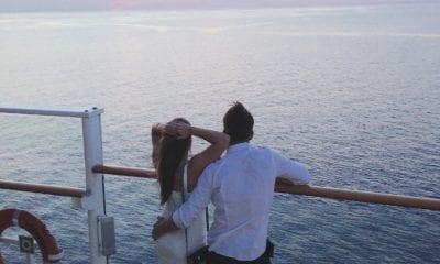 couple cruising sunset
